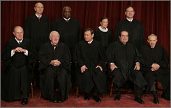 U.S. Supreme Court justices are, l-r, front row, Anthony M. Kennedy, John Paul Stevens, Chief Justice John G. Roberts, Antonin Scalia and David Souter; second row, Stephen G. Breyer, Clarence Thomas, Ruth Bader Ginsburg and Samuel Alito.