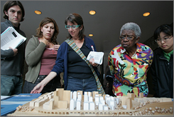 Residents look over an architectural model of Columbia University expansion plans at an open meeting Sept. 19.