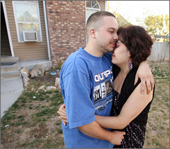 Cesar Coyt, 18, hugs his mother, Noemi Marin, Tuesday in front of a home they rent in Utah.