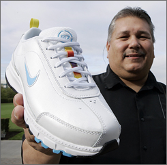Sam McCracken, manager of Nike's Native American business program, shows the new Nike Air Native N7 shoe.