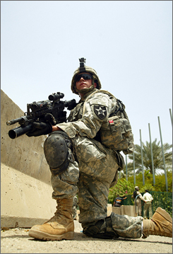 A U.S. soldier takes a combat position while on patrol in central Baghdad in this July 2007 file photo. Defense Secretary Robert Gates will request an additional $42 billion to fund the wars in Iraq and Afghanistan in 2008.