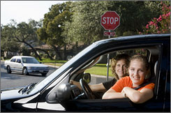 Vicki Newton, left, monitors the driving of daughter Aly, 15, while the high school sophomore has a learner?s permit. Aly ran a stop sign last spring shortly after getting her learner's permit.