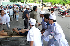 Heath workers rush an injured worker to a hospital in southern Can Tho City, Vietnam Wednesday.