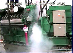 In this image from video released by the Department of Homeland Security, smoke pours from an expensive electrical turbine during a March 4, 2007, demonstration by the Idaho National Laboratory, which was simulating a hacker attack against the U.S. electrical grid.
