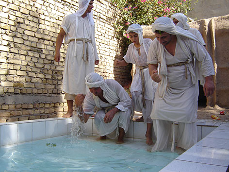Water plays big role: Sabian grooms wash their hands after baptism in Baghdad. Members of the centuries-old sect, which is neither Muslim nor Christian, believe couples should be baptized before marriage.