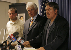 Nye County District Attorney Robert Beckett, right, answers a question from the media as Nye County Sheriff Tony DeMeo, center, and detective David Boruchowitz look on during a news conference in Pahrump, Nev. on Friday.