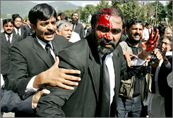 Pakistani lawyers help an injured colleague following clashes with police during a march towards the Election commission office in Islamabad on Saturday.