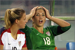 Hope Solo, right, posted an apology on her My Space page.
