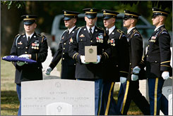 An honor guard team carries the cremated remains of Army Sgt. John W. Mele of Glennville, Ga., during a funeral ceremony at Arlington Cemetery on Thursday.