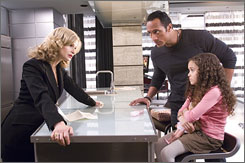 "Kyra Sedgwick, left, Dwayne ""The Rock"" Johnson and Madison Pettis in star in The Game Plan."