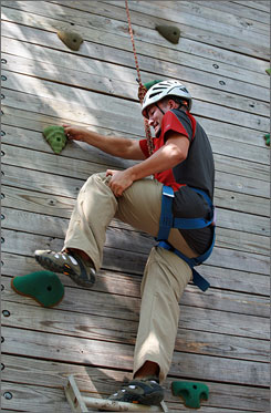 Former Marine sergeant Carlos Leon of Fort Lauderdale, who lost the use of his legs in Iraq, tackles Camp ASCCA's climbing wall.
