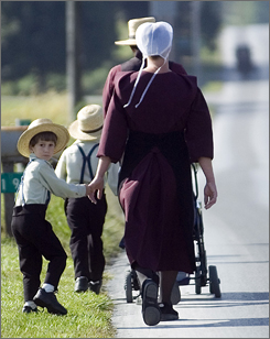 Amish people walk to a gathering to mark the anniversary of the schoolhouse terror.