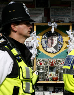 A tribute to Brazilian Jean Charles de Menezes, who was shot dead by British police in London as he boarded an underground train in July 2005, is seen at Stockwell underground station in south London in this August 2 file photo.