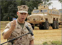 Brig. Gen. Michael Brogan talks about the Mine Resistant Ambush Protected (MRAP) vehicle, seen in background, at the U.S. Army's Aberdeen Proving Grounds in Aberdeen, Md., on August 24, 2007.