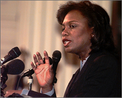 Anita Hill addresses a crowd gathered to commemorate Martin Luther King Day at City Hall in Burlington, Vt., in this Jan. 1999 file photo.