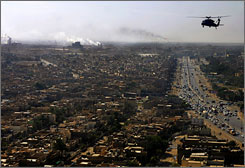 A U.S. Army Blackhawk helicopter flies over a residential neighborhood south of Baghdad.