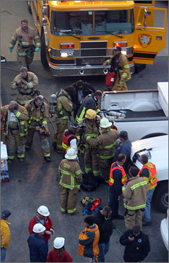 Rescue workers put on air tanks before heading into an Xcel Energy hydroelectric plant in which five maintenance workers were trapped in a pipe.