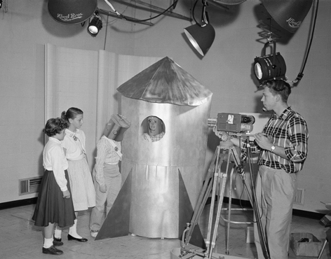 June 13, 1958: This day, the story on the space race was presented not by experts, but by elementary school pupils in Hagerstown, Md. Their science program A Visit to the Planets was televised in classrooms across the city. The pupils: Judy Snyder, left, Nancy Grove, Larry Michael and Stephen Murray.