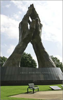 A massive praying hands sculpture towers over the Oral Roberts University campus in Tulsa.