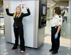 "A TSA agent scans airline passenger Kelsi Dunbar, using the new ""backscatter"" x-ray technology at Sky Harbor Airport in Phoenix."