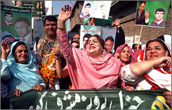 Women of the Pakistan Muslim League celebrate President Pervez Musharraf's re-election in Peshawar on Sunday. The Supreme Court will rule on the vote.