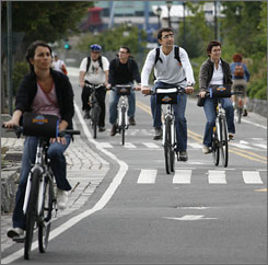 Bicyclists travel on New York City's West Street bike path. New York hopes to add 200 miles of bike lanes by 2010.