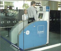 Workers test a shoe scanner at the Orlando International Airport in July 2006.