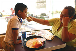 Anayancin Llanes, 35, and her son Maximiliano, 4, eat at the Taco Bell in Apodaca in northern Mexico.