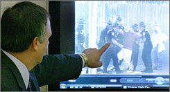 A defense attorney points to video showing inmate Martin Lee Anderson, center, during the trial of eight boot camp employees accused of negligence in Anderson's 2006 death in Panama City, Fla., on Tuesday. A GAO study found that inadequacies at boot camps have been factors in the deaths of several inmates.
