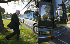 Republican presidential hopeful Sen. John McCain, R-Ariz., boards his campaign bus following a stop at the Grinnell Medical Center Wednesday in Grinnell, Iowa