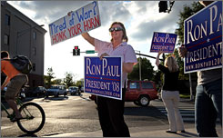 "Supporter Cheryl Scott campaigns recently for Ron Paul at an intersection in Nashville. She says Paul is ""really one of us. He doesn't seem like a politician."""
