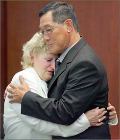 Former boot camp guard Raymond Hauck, right, consoles former camp nurse Kristin Schmidt after Schmidt testified during the trial of eight former boot camp employees accused of negligence in the 2006 death of inmate Martin Lee Anderson. On Friday, all were acquitted.
