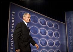 President Bush makes his way onto the stage to speak on free trade Friday at the Radisson Miami Hotel.