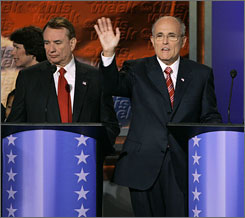Tommy Thompson, left, dropped out of the presidential race in August and now supports Rudy Giuliani, right.