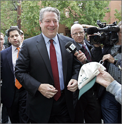 Gore is given a cap as he arrives for a news conference in Palo Alto, Calif. on Friday.