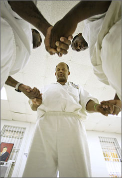 Inmates Steven Gabriel, center, D'Michael Newman, right, and Anthony Green pray at the Carol Vance Unit, n Richmond, Texas. Gabriel and Newman were released from the faith-based  prison later that morning.