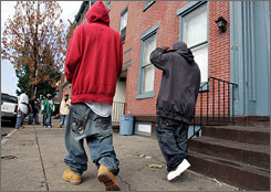 Two young men strut in Trenton, N.J., where a proposed law on sagging trousers could mean a stain on citizens' records. Such plans for bans are drawing attention nationwide.