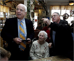 Sen. John McCain gets a tour Sunday of Robie's Country Store in Hooksett, N.H. from owner George Robie. A new state poll shows McCain's supporters were the most firmly committed among rivals, placing him third.