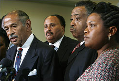 "House Judiciary Chairman John Conyers, D-Mich., left, speaks about a meeting regarding the case of the ""Jena 6"" defendants with Rev. Al Sharpton, second from right, on Capitol Hill in Washington on September 25. Listening in are Melissa Bell right, mother of defendant Mychal Bell, and Martin Luther King III."