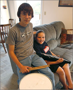 Chris La Mar, 15, and sister Samantha, 12, now wear ear plugs to indoor band practice at Dixie Heights High School.