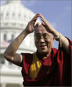 Tibet's exiled spiritual leader the Dalai Lama bows to the crowd outside of the Capitol after receiving the Congressional Gold Medal in Washington on Wednesday.