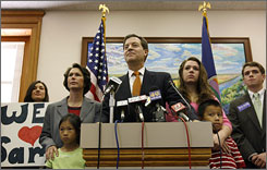 Sen. Sam Brownback, R-Kan., along with wife Mary, left, daughters Elizabeth, third right, and Jenna, second left, and son Mark, second right, announces he has run out of money for his presidential campaign.