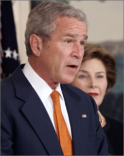 With first lady Laura Bush at his side at the White House, President Bush announces new sanctions Friday against Burma.