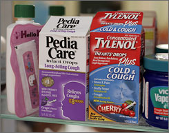 Cold and cough medicines targeted for children sit on a medicine shelf. In two separate votes, federal panelists said the medicines shouldn't be used in children younger than 2 or in those younger than 6. A third vote, to recommend against use in children 6 to 11, failed.