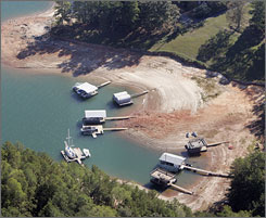 Exposed lake bed and beached boat docks are shown at Lake Lanier in Cumming, Ga. Rivers throughout the Southeast are turning to dust, towns are threatening to ration dwindling water supplies and lawmakers are pointing fingers as the region struggles with an epic drought that seems to be getting worse.