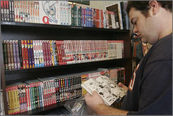William Pearson of Arlington, Va. looks at a volume of Reborn in a Barnes & Noble. Manga graphic novels are waning in popularity in Japan but are still wildly popular in the United States, primarily among young adults.