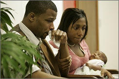 Katal Yancy waits with his wife Dominique and their daughter Zaria in Fort Stewart, Ga. He is one of more than 48,000 Iraq and Afghanistan veterans who've sought treatment for post-traumatic stress disorder as of July 2007.