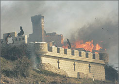 "Fire consumes what is known as ""The Castle"" in Malibu Knolls as strong, gusting winds pushed flames through Malibu, Calif. on Sunday."