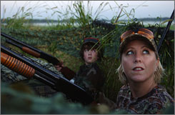 Nicholas Flesland and Christy Hurley watch for geese from their blind near Lino Lakes, Minn. Fewer recreational hunters in the U.S. could mean a drain on the millions of dollars the sport fetches for U.S. conservation efforts.