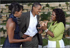 One-woman industry Oprah Winfrey, right, chats with Barack Obama and his wife, Michelle at a fundraiser that Winfrey hosted for him last month at her mansion in Montecito, Calif.